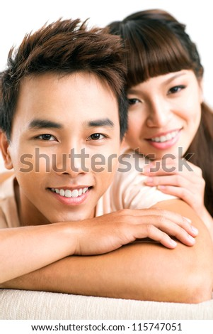 Close-up of faces of girlfriend and boyfriend - stock photo