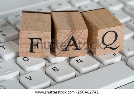 Close-up Of Faq Wooden Cubes On Computer Keyboard - stock photo