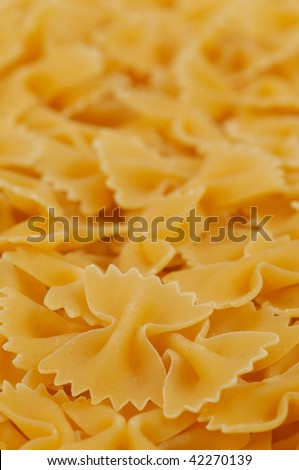 Close-up of farfalle dried pasta. Shallow DOF. Focus on the front row.