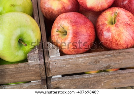 Close up of farmers crates with assorted ripe apples. - stock photo
