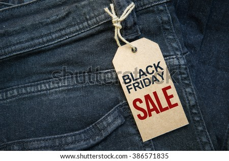 Close up of fashion jeans and Black Friday sales tag. - stock photo