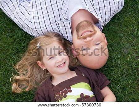 Close Up of Father and Daughter - stock photo
