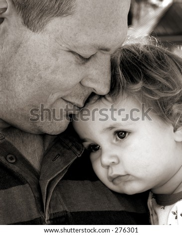 Close up of father and daughter in black and white - stock photo