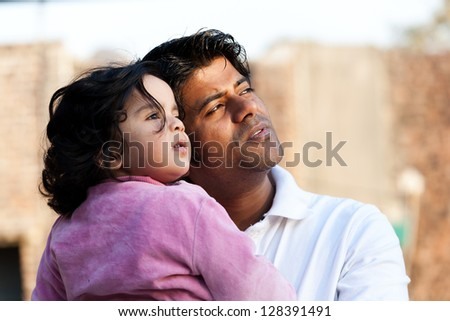 close up of father and daughter, Indian man with his one year old daughter - stock photo