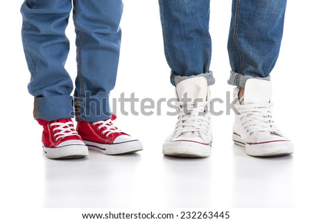 Close-up of father and little son feet in shoes.