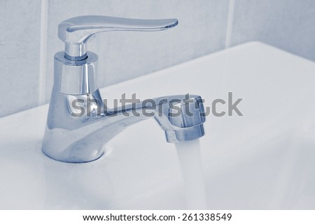 close up of faucet in bathroom - stock photo