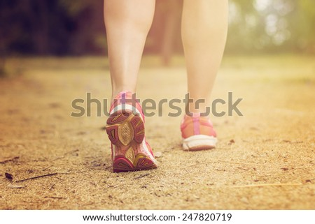 Close up of feet of a female runner - stock photo