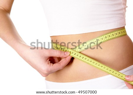 Close-up of female belly with measuring tape around it - stock photo