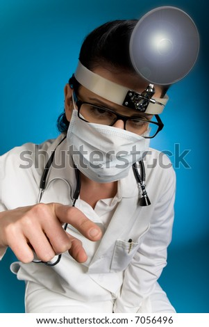 Close-up of female doctor listening during medical exam - stock photo