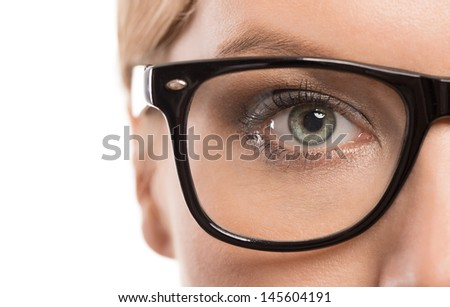 Close up of female eye with glasses isolated on white background with copy space