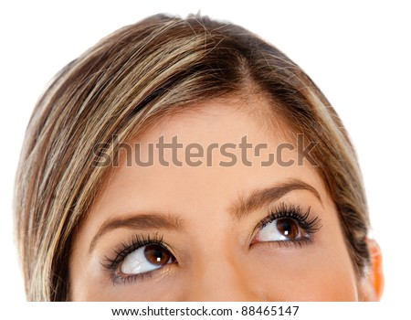 Close up of female eyes looking up - isolated over a white background - stock photo