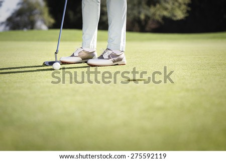 Close up of female golf player putting on green, with empty copyspace, background for text. - stock photo