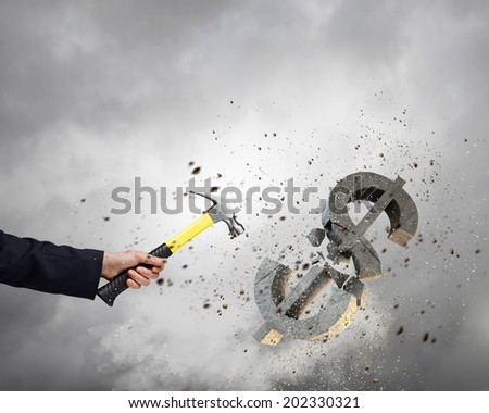 Close up of female hand crashing dollar sign - stock photo
