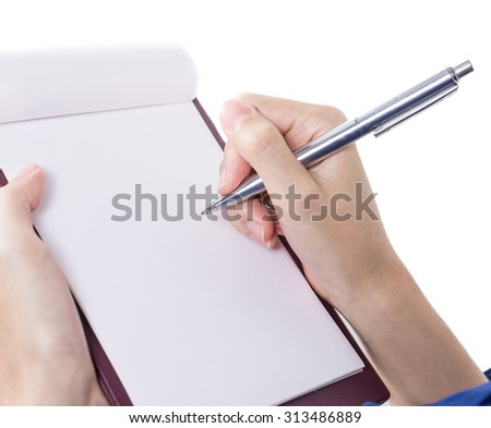 Close-up of female hand holding a pen and writing - stock photo