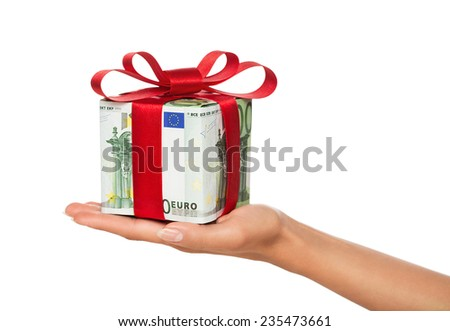 Close up of female hand holding gift box made of euro banknotes isolated on white background - stock photo