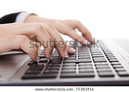 Close-up of female hand touching buttons of computer keyboard - stock photo