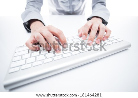 Close-up Of Female Hand Typing On Keyboard