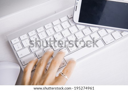 Close up of female hand using Keyboard. Business concept. Selfie shot. Horizontal - stock photo