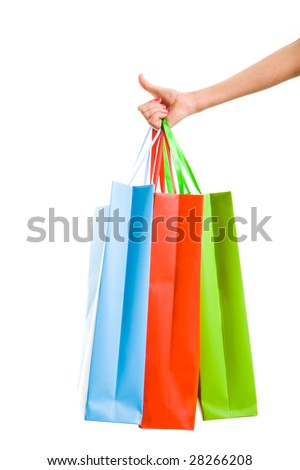 Close-up of female hand with three paperbags showing sign of okay - stock photo