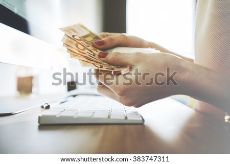 Close up of female hands counting euro bills, filtered image, businesswoman working financial adviser and counting money banknotes - stock photo