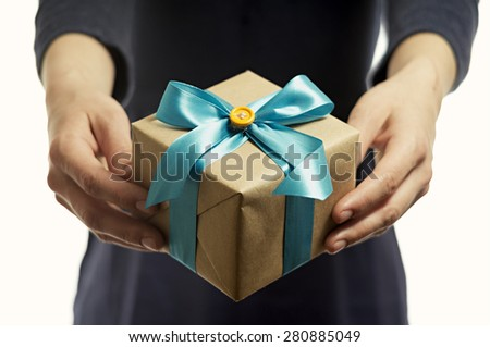 Close-up of female hands holding a present - stock photo
