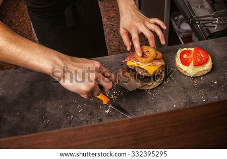 Close Up Of Female Hands Making Burgers - stock photo