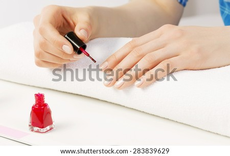 Close up of female hands making manicure