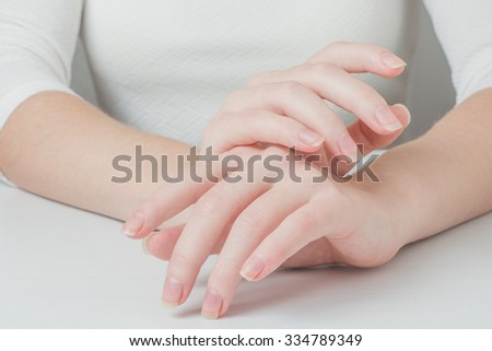 close up of female hands. soft light.