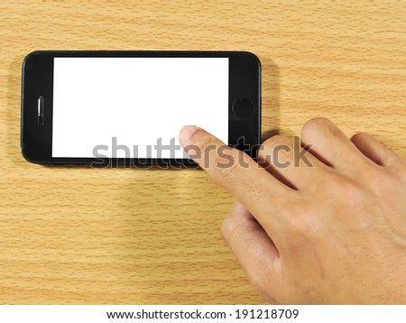 Close-up of female hands using a smart phone on wooden desk. - stock photo