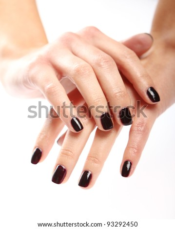 Close up of Female hands with black manicure - stock photo