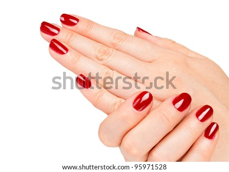 Close up of Female hands with red manicure - stock photo