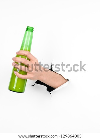 close-up of female holding a green beer bottle through a white paper, isolated - stock photo