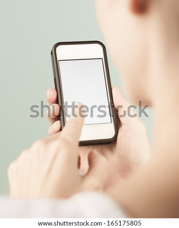 Close up of female holding blank smart phone - stock photo