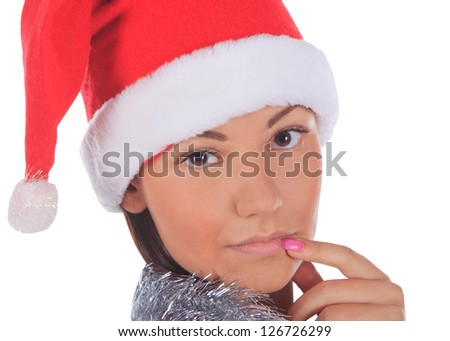 Close up of female in Santa Claus hat over a white background. - stock photo