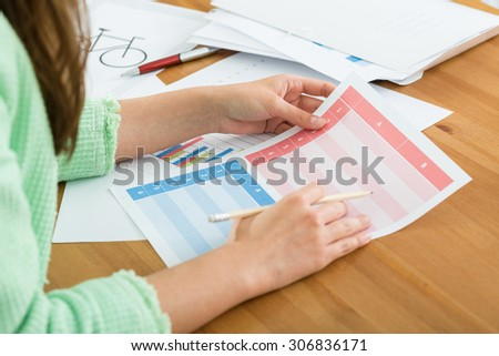 Close-up of female office worker doing paperwork