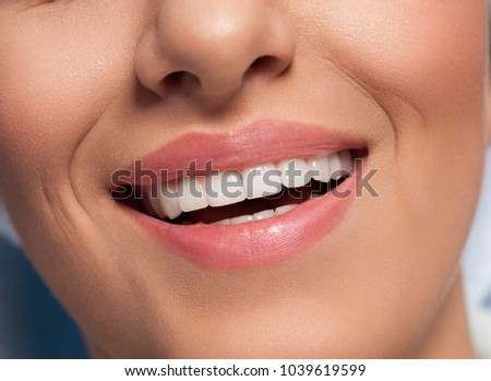 Close up of female perfectly white healthy teeth smile