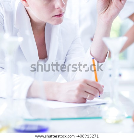 Close up of female scientist during work in lab - stock photo