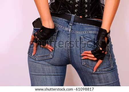 Close up of female sexy back dressed in jeans - stock photo