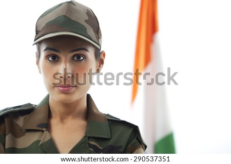 Close-up of female soldier in front of Indian flag - stock photo