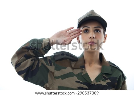 Close-up of female soldier saluting