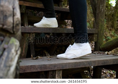 Close up of female walking upstairs, step up - stock photo