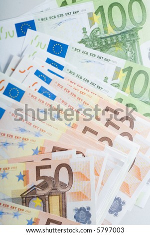 Close-up of fifty and hundred euro banknotes in a row