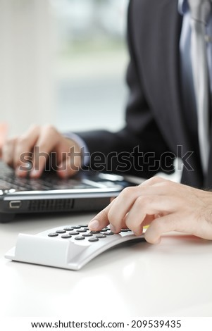 Close-up of financial advisor analyzing data in office. Business people.  - stock photo