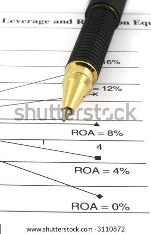 close-up of financial analysis and ballpoint pen - stock photo