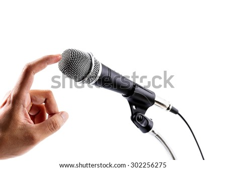 Close up of fingers check a microphone - stock photo