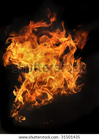 Close up of fire and flames on a black background  - stock photo