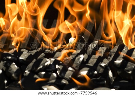 close up of fire burning in a grill - stock photo
