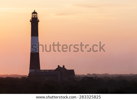 Close up of Fire Island Lighthouse in foggy sunrise