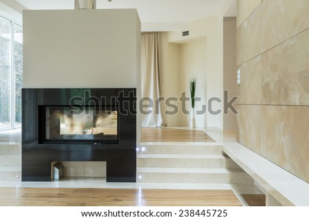 Close-up of fireplace in bright luxury mansion - stock photo