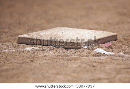 Close up of first base on a baseball field - stock photo